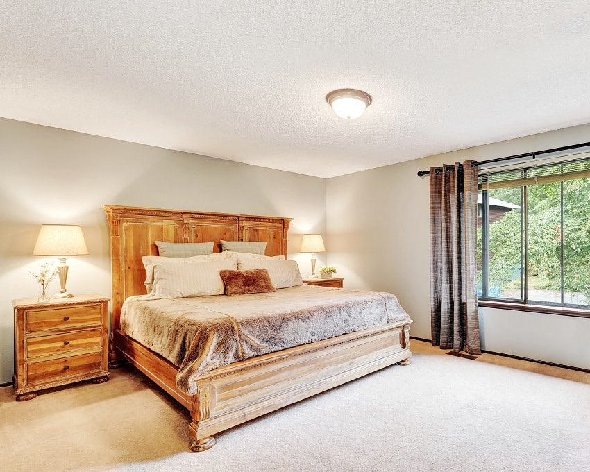 american bedroom interior with queen size bed wooden desk and a white flat paint ceiling