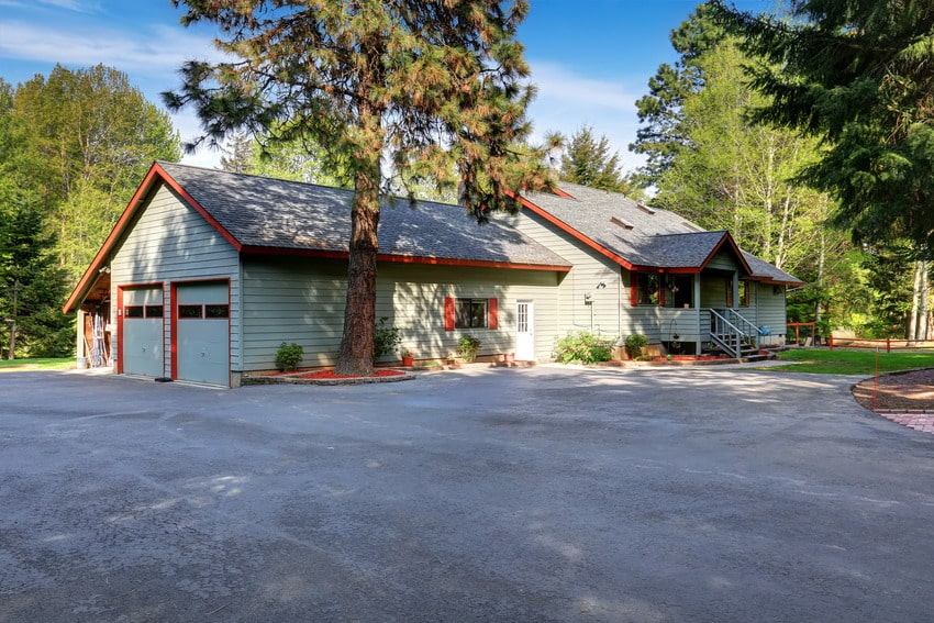 American country house exterior with wide asphalt driveway