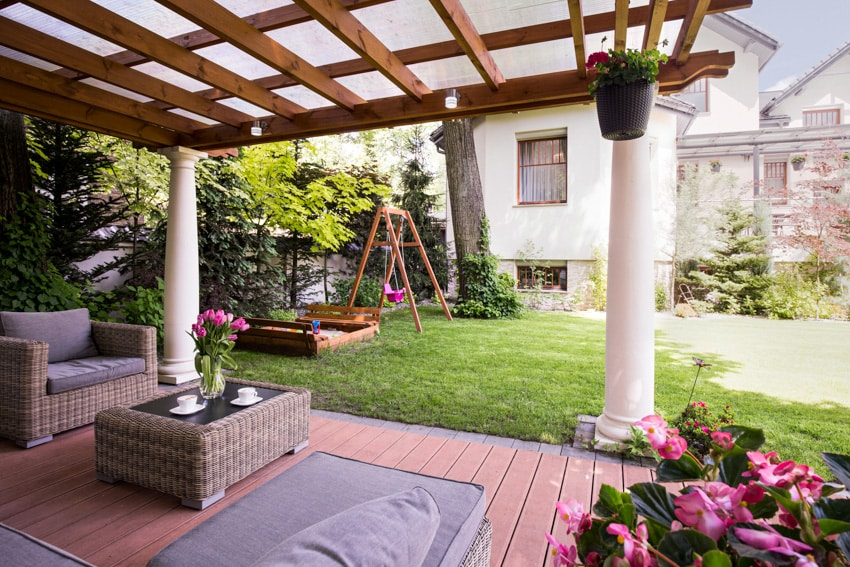 Backyard pergola with down light outdoor furniture and greeneries