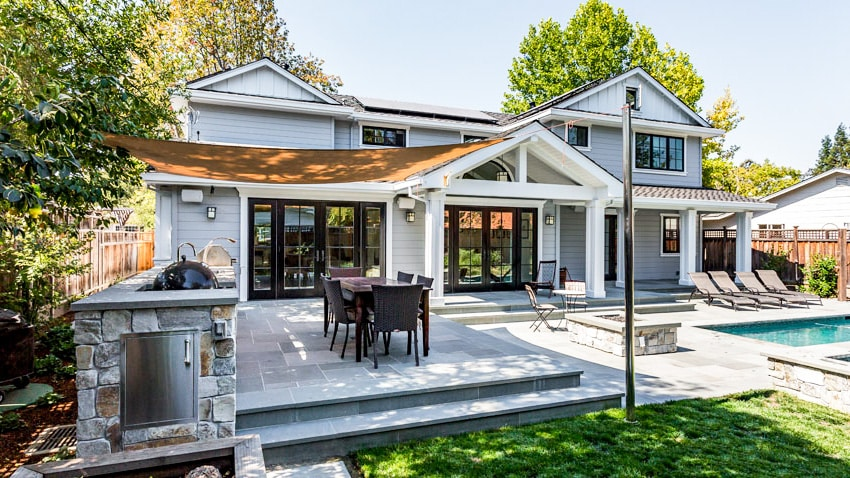 Backyard with outdoor kitchen canopy cover and patio folding door