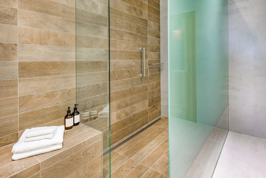 Bathroom glass divider light brown wall and bench