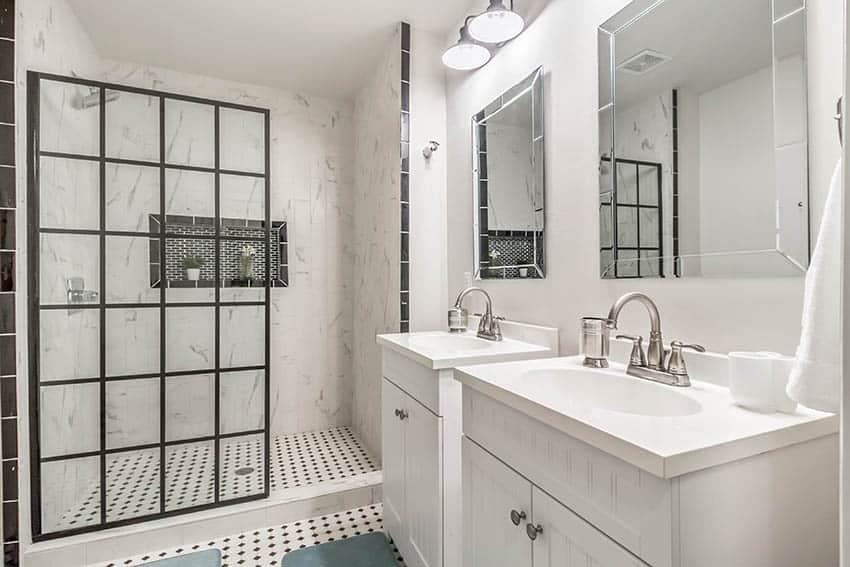 Bathroom shower with ceramic mosaic tile floors french glass style enclosure quartz walls