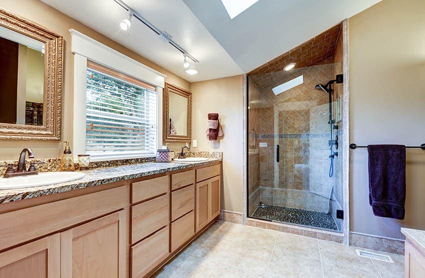 Bathroom with dark river rock shower floor