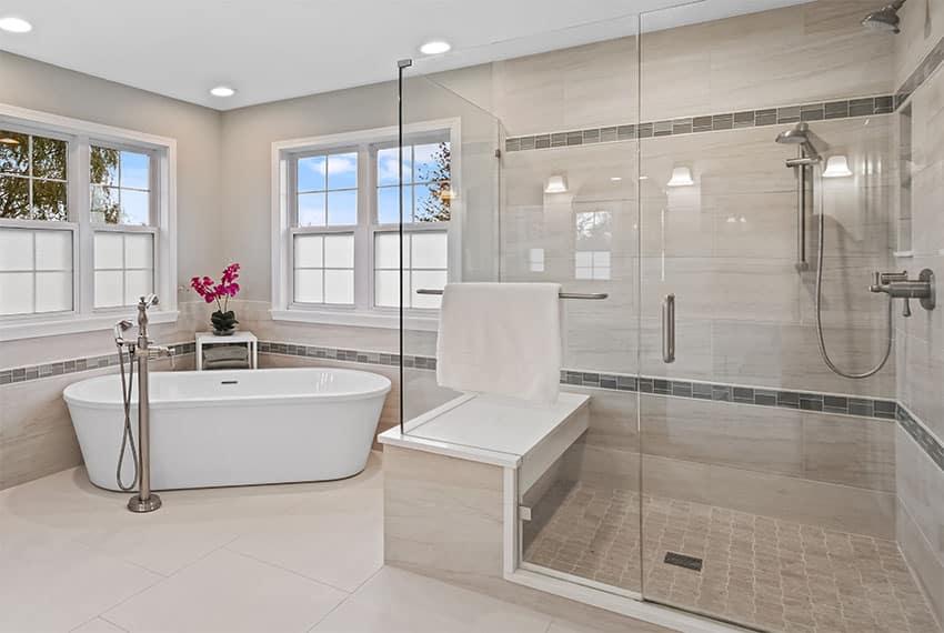 Bathroom with frameless shower doors and bathtab