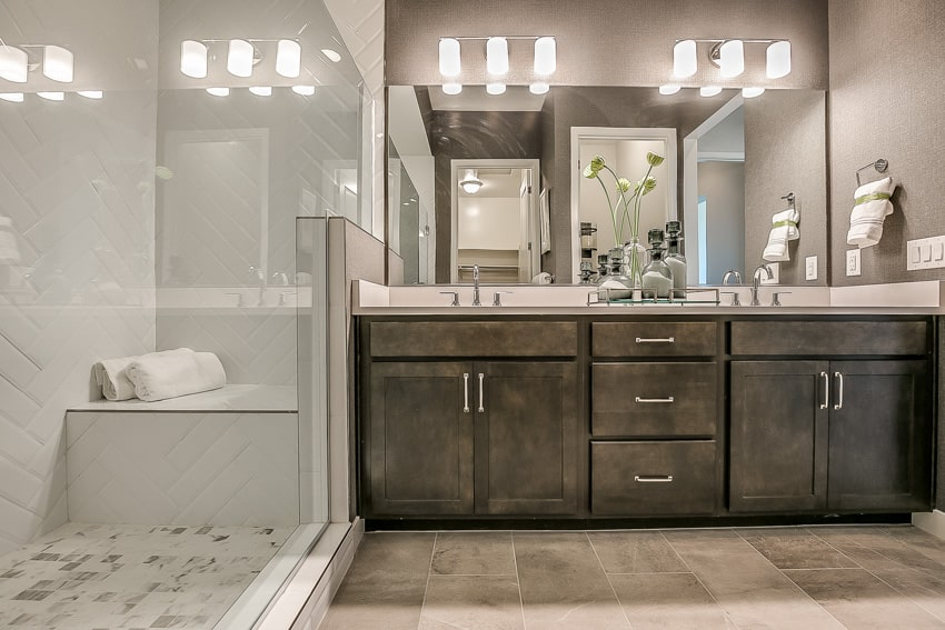 Bathroom with built in shower bench mirror and wood drawers