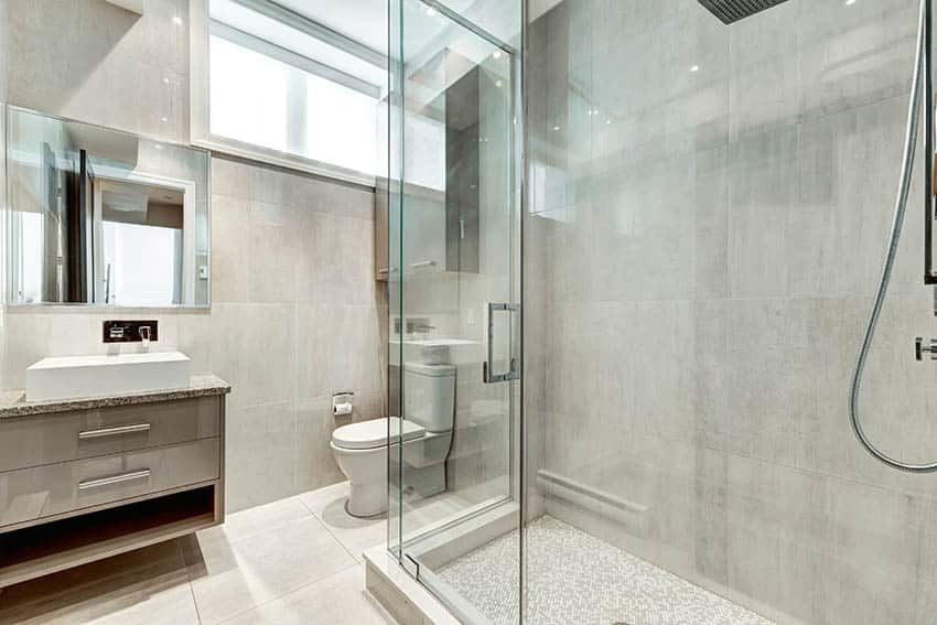Bathroom with small glass mosaic tile shower floor floating vanity