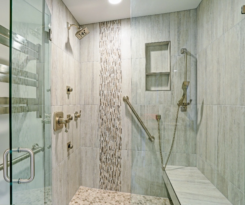 bathroom with walk in shower built in floating bench glass door and mosaic vertical stripe tiled