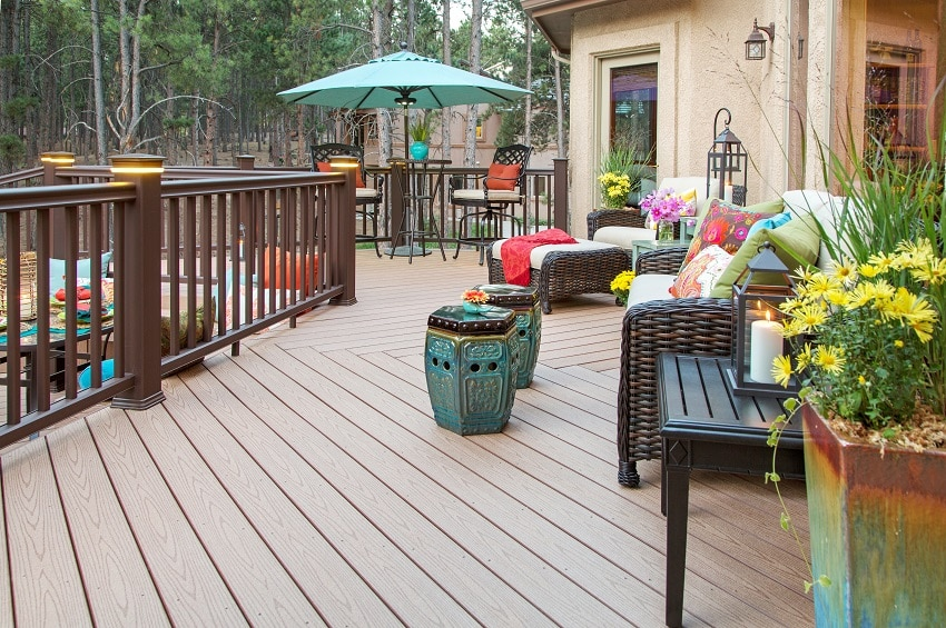 beautiful backyard composite decking with built in lighting and fully decorated vibrant colorful furniture and decor