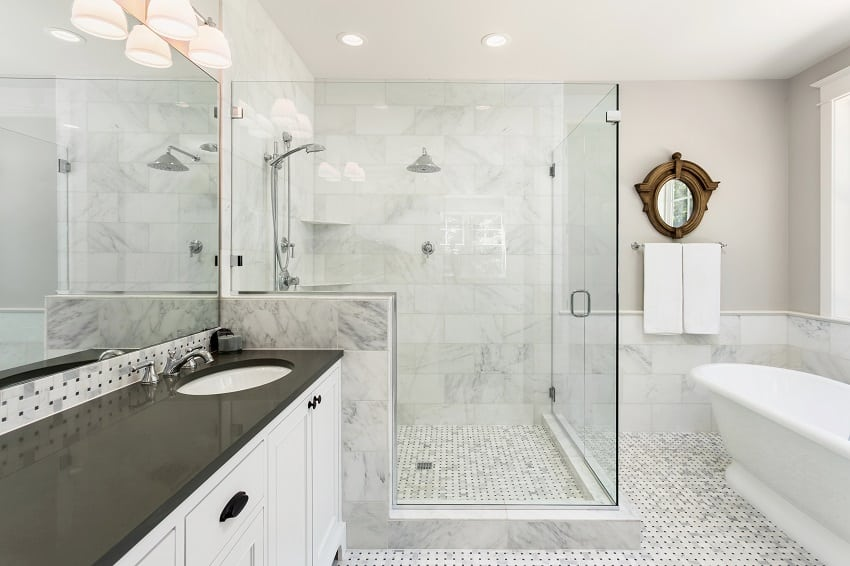 beautiful bathroom with shower bathtub and sink with high end furnishings and tempered glass shower stall