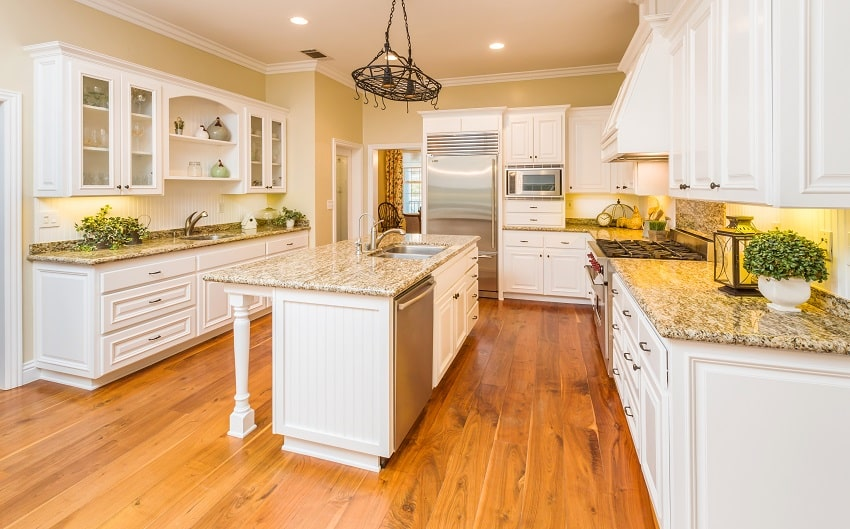beautiful custom kitchen interior with marble countertop and wooden flooring