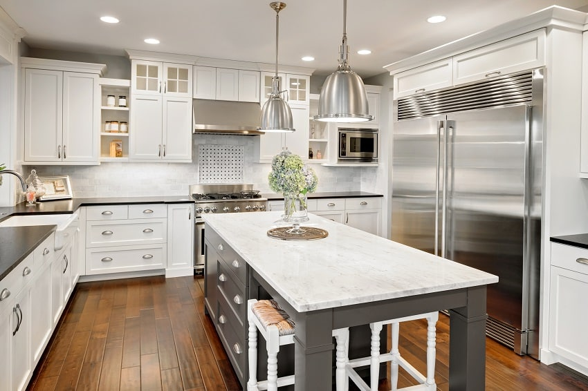 beautiful kitchen with white cabinets stainless steel fridge and stove