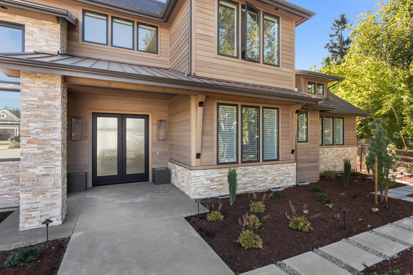 Beautiful large luxury home with cypress siding exterior