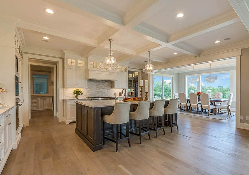 Beautiful luxury kitchen with coffered ceiling white cabinets solid wood island marble countertops