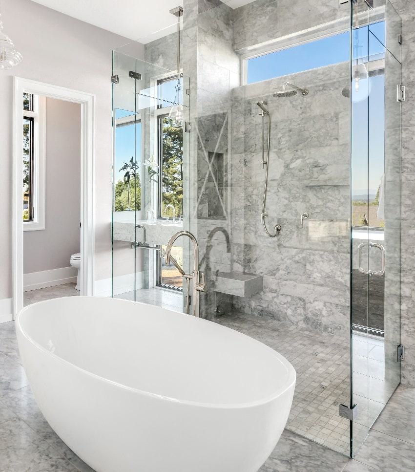beautiful marble tiled bathroom with corner shower bench