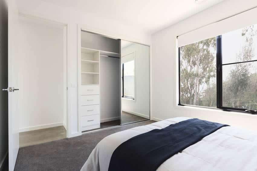 Bedroom sliding closet doors carpet floor