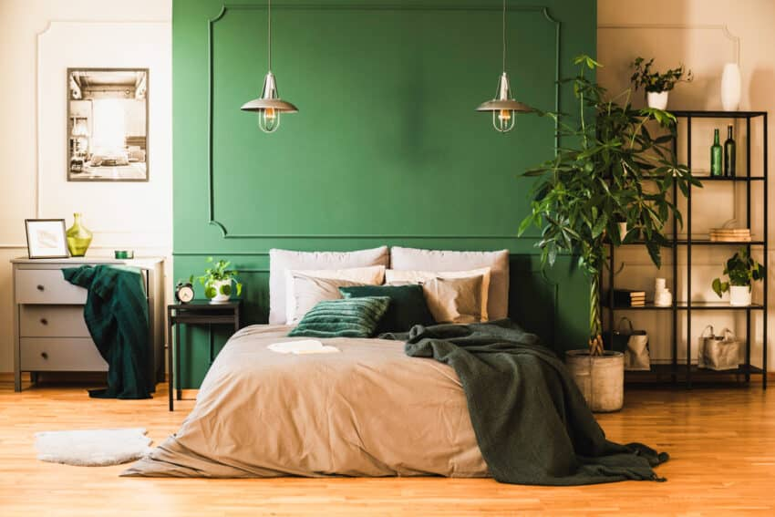 Bedroom with green wall blanket and minimalist shelf
