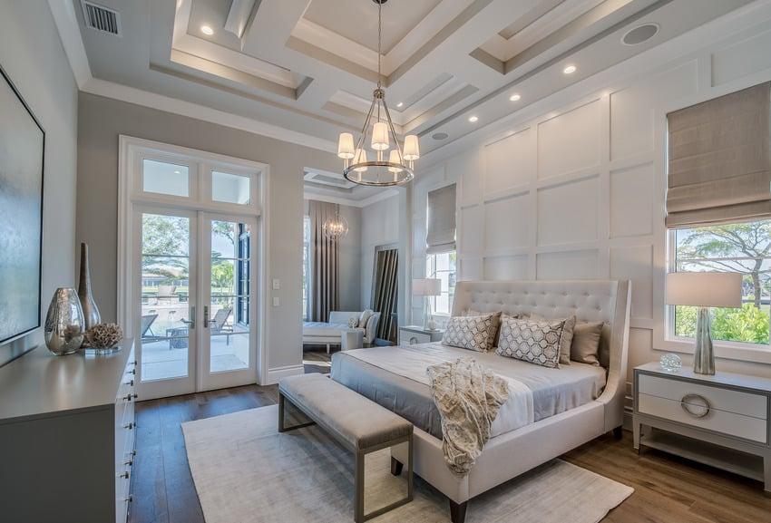 Master bedroom in classic white interiors