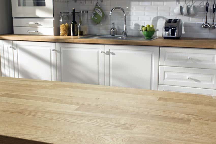 Butcher block kitchen countertops with white cabinets