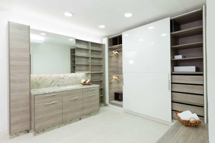 Closet with sliding door wood drawer flooring mirror