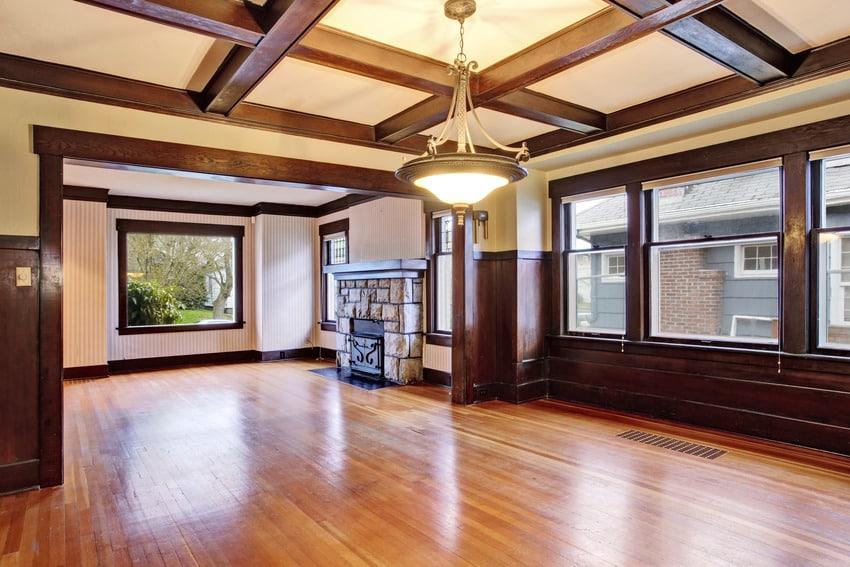Empty room features wooden beams