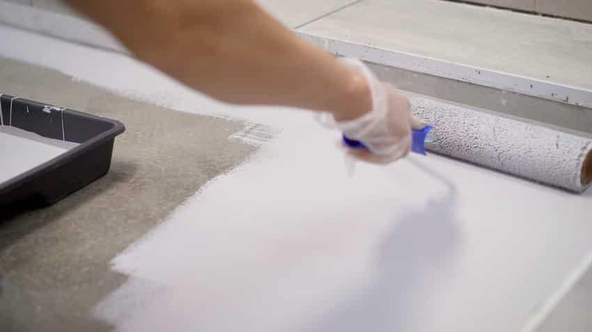 Concrete floor repair work with acrylic waterproofing