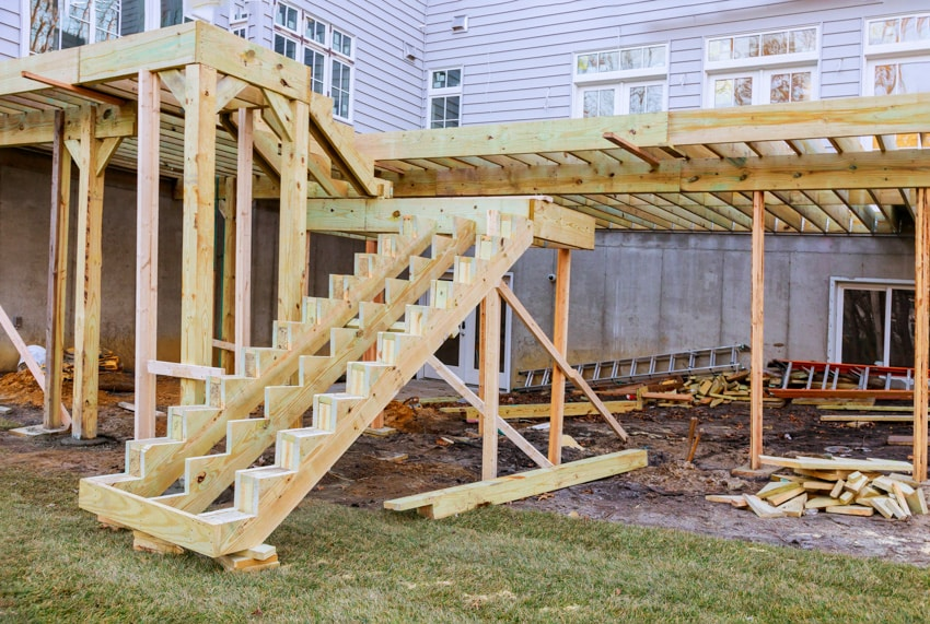 Construction of wooden deck outside of white house