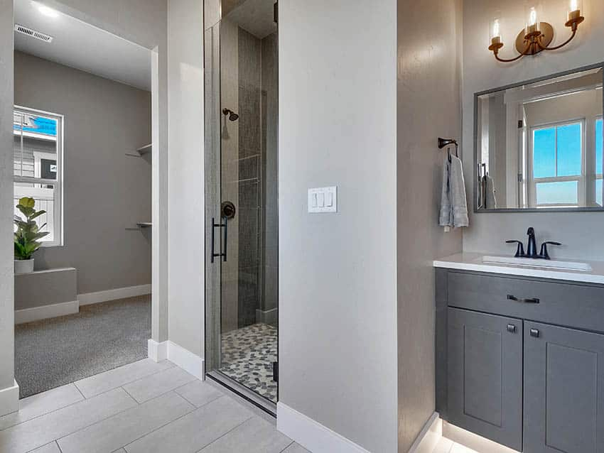 Contemporary bathroom with river rock tile shower
