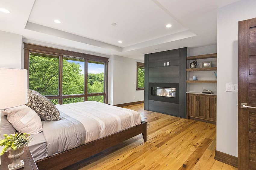 Contemporary bedroom with platform bed fireplace hardwood floors