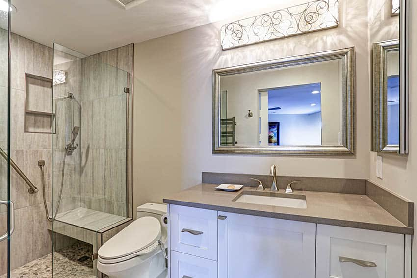 Contemporary guest bathroom with river rock tile floors