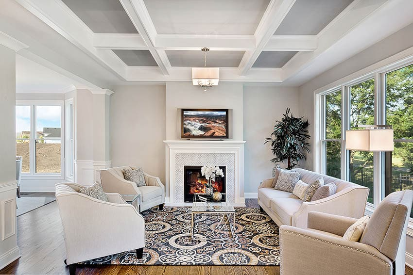 Contemporary living room with coffered ceiling wood flooring tv above fireplace