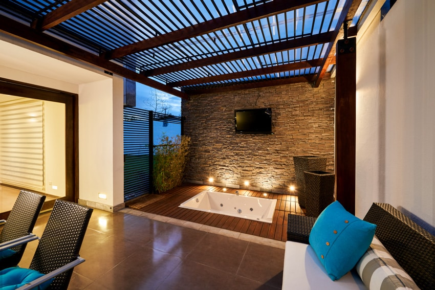 Contemporary patio with wood pergola lighting bathtub wall mounted television