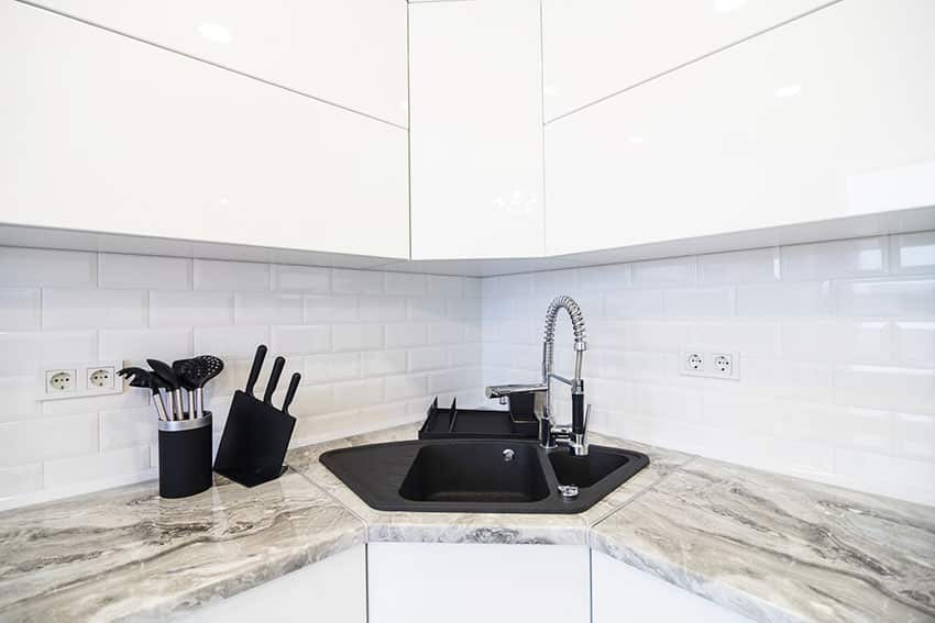 Corner kitchen sink with marble countertop white cabinet