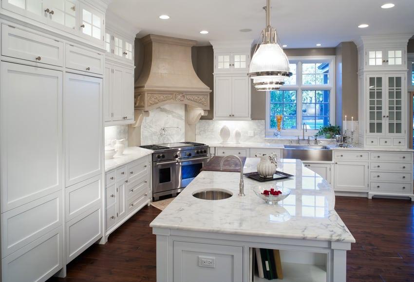 Corner stove in kitchen with classic white interior