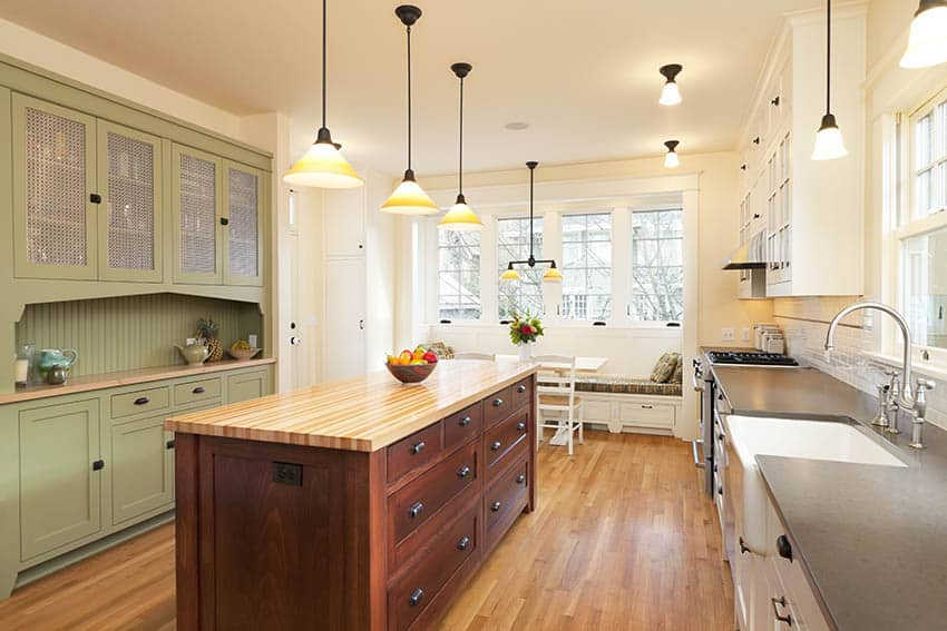 Country kitchen with douglas fir wood flooring two tone cabinets
