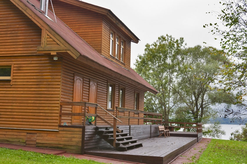 Country house with exterior wood siding close to lake