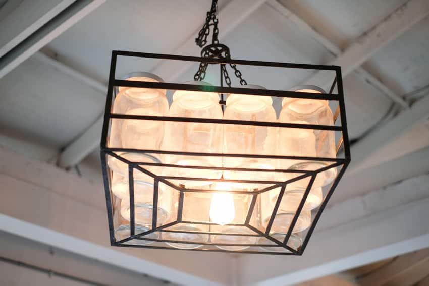 Customized mason jar light hanging from ceiling