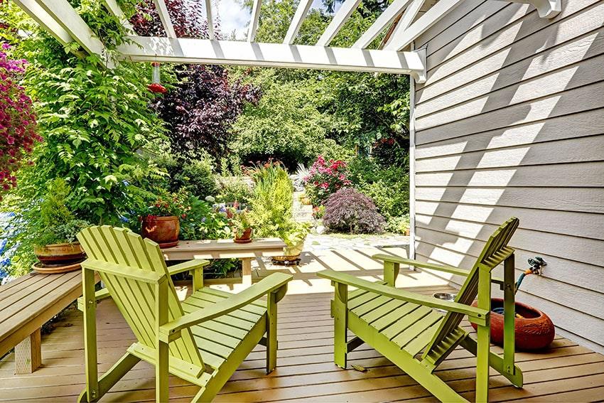 Deck pergola with adirondack chairs
