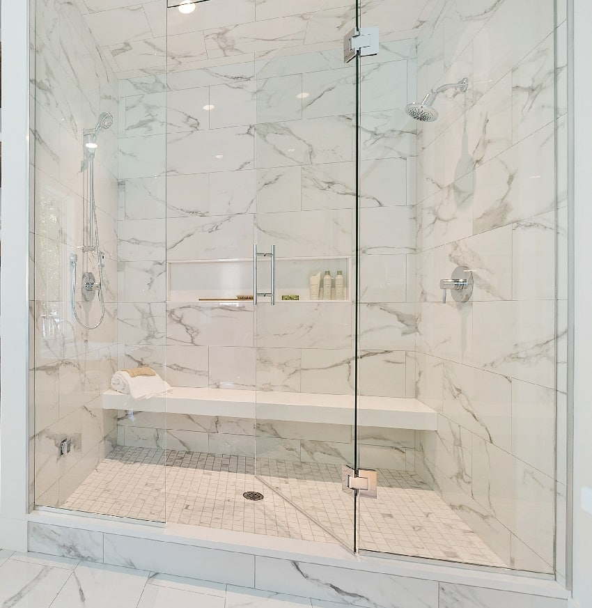 decorative tile with long floating bench and glass stall in shower
