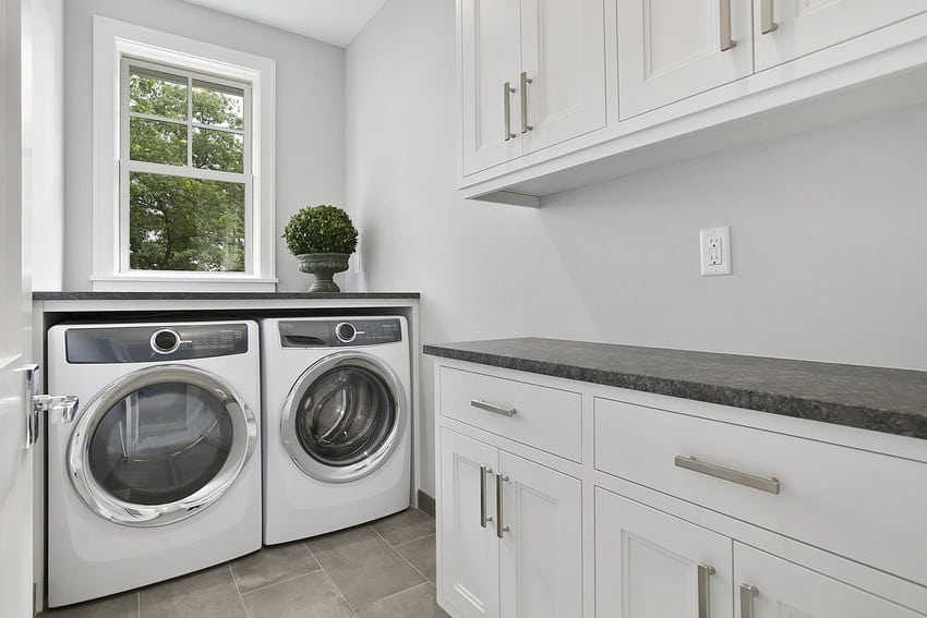 Electric dryer in classic white laundry room interior