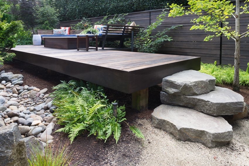 Elevated wood deck with outdoor furniture