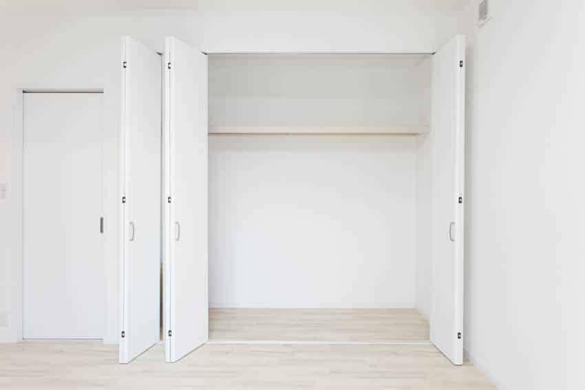Empty closet laminate flooring white walls