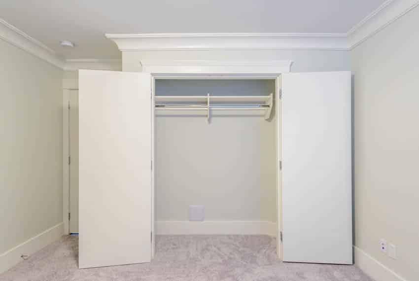 Empty reach in closet in bedroom