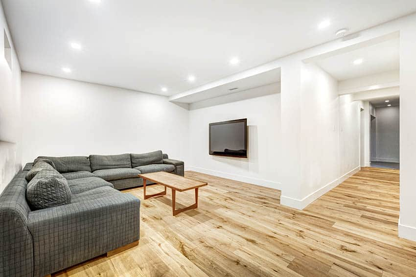 Finished basement with sheetrock walls sectional sofa