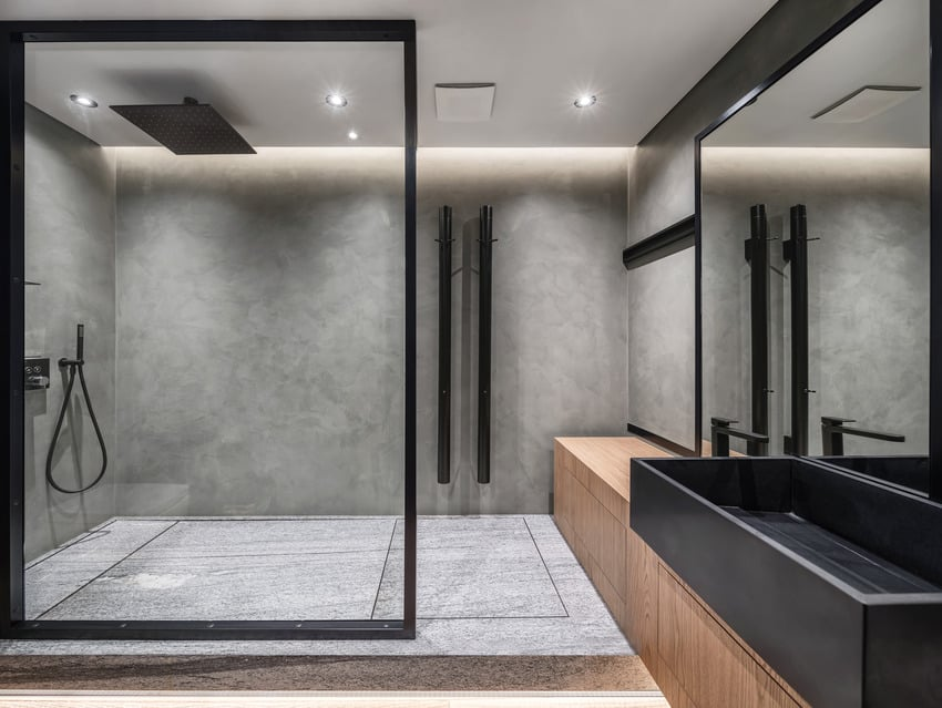 Framed modern bathroom with gray cultured marble walk in shower