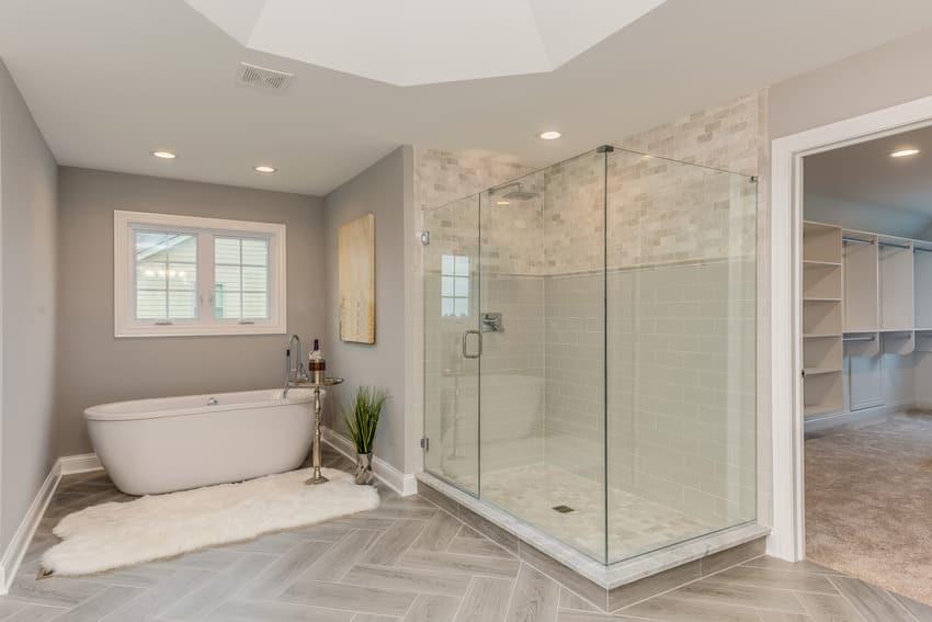 Frameless shower door in classic white bathroom