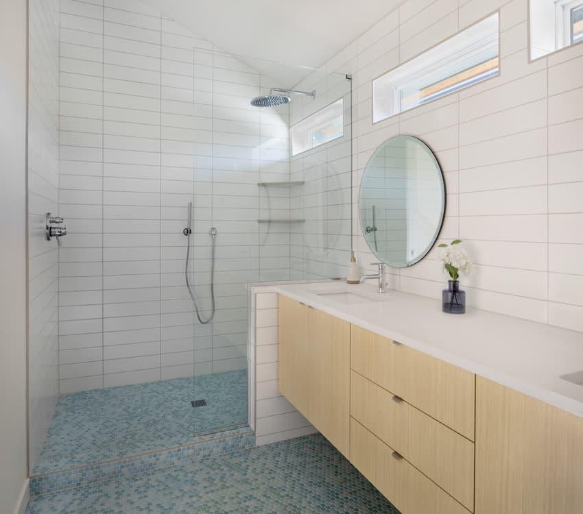 Frameless shower door and glass mosaic tile
