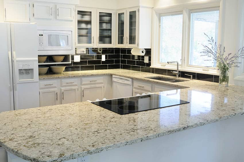 Granite kitchen countertop peninsula with electric cooktop