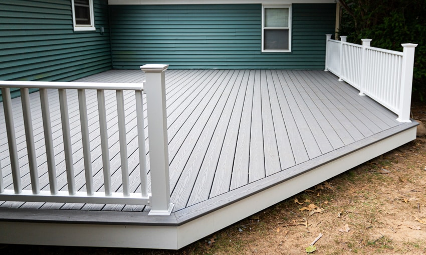 Gray composite deck with fence house exterior