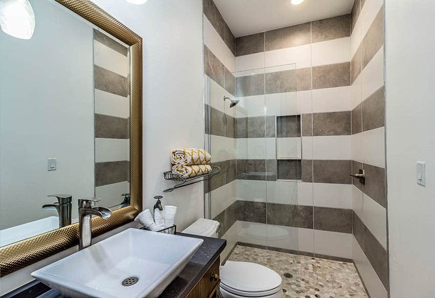 Guest bathroom with shower and mosaic porcelain tile floors