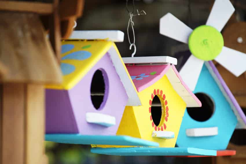 Hanging handmade and painted colorful wooden birdhouses